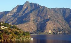 """Lake Atitlán in Guatemala is ringed by Mayan villages and its shores are strewn with archeological sites and ruins, some said to be the mythological """"underwater city"""" Chiutinamit."""