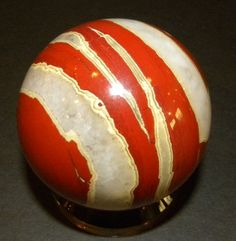 Red Jasper - Vibrant and energetic. Can attract love and passion. Jasper Stone, Red Jasper, Minerals And Gemstones, Rocks And Minerals, Crystal Sphere, Crystal Ball, Glass Rocks, Crystal Meanings, Rock Collection