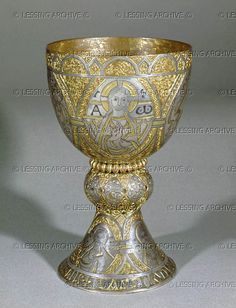 The Tassilo Chalice, a gift from Duke Tassilo III of Bavaria and his wife Liutpirc to the Abbey of Kremsmuenster. Gilded copper decorated with niello and silver medallions of Christ and the four Evangelists. Around 770, H:25,5 cm