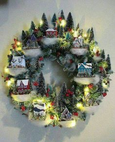 This is truly a very unique Christmas wreath that you can do because you can find more than leaves and flowers on it, but an entire miniature village. Christmas village wreath Once again it's Christmas! It's… Continue R Noel Christmas, Winter Christmas, Christmas Ornaments, Pallet Christmas, Christmas Wreaths With Lights, Black Christmas, Modern Christmas, Family Christmas, Christmas Projects
