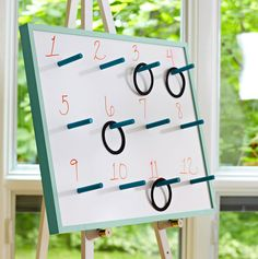 How to build a game board w/ pegs for ring toss use the other side as a dry erase board. Idea from Lowe's Home Improvement store.