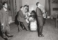 Dizzy Gillespie Allstars-Town Hall-16 May 1945-Gillespie listens as Charlie Parker solos. Harold 'Doc' West,drums,Slam Stewart, bass-