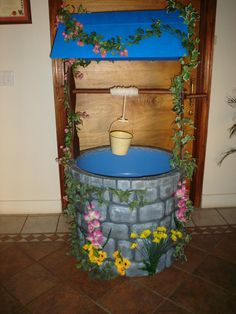 Wishing Well made from a plastic basin, old broom handel, hardboard, wire mesh, cardboard and polystyrene.....used as a stage prop.