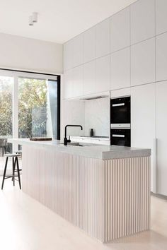 Minimalist Modern Kitchen Design Ideas and Inspiration. The fluted wood makes a statement and focal point in this kitchen remodel. |Apartment Therapy