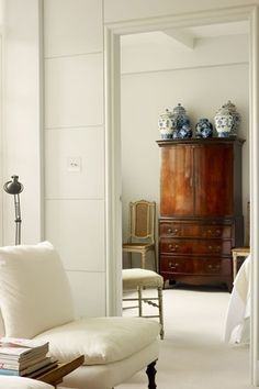 Ann Boyd Small London Flat - Real Homes (houseandgarden.co.uk) The white really shows off the armoire...