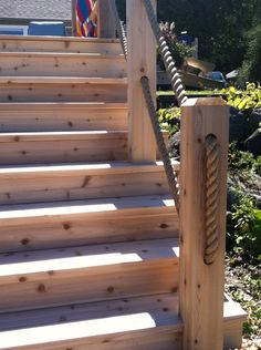 Fascinating deck stair railing lowes to refresh your home stairs Outdoor Stair Railing, Deck Railings, Rope Railing, Garden Stairs, Deck Stairs, Rope Fence, Outdoor Steps, Porch Steps, Sloped Garden