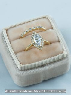 One of my favorites. Vintage marquise diamond with marquis halo and solitaire plain band. Vintage bubble wedding band with diamonds and milgrain detail. Both in 14K yellow gold. R6201E #wilsondiamonds #timeless
