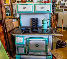 https://flic.kr/p/NCfc7P | Wood Burning Stove--DSC00079--Pismo Beach, CA | A Copper Clad brand wood burning cook stove. My grandmother cooked us meals on a wood burning stove similar to this one. There was a porch directly off the kitchen where she maintained stacks of firewood precisely cut to fit into the stove's firebox.  Even as a kid I realized it was a pretty amazing process compared to the more modern stove my mother used.   Antique store scenery encountered on our California road…