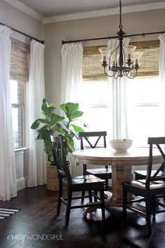 love the bamboo roman shades with the sheer curtains. Would need a bigger table though. :)