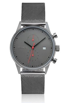 Our TXM086 is the definition of contemporary style, bringing elegance, design and style together within one timepiece. Featuring our famous combination of red features based upon a matte black face, set within we have gun metal hands and logo. Housed within our polished chronograph case this will become the centre point of your collection - Complemented with our high precision stainless steel strap.      Case Diameter - 42mm     Movement - Chronograph       Band Material - Grey Meshband…