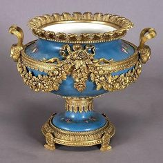 Louis XV Style Gilt Bronze Mounted Sevres Porcelain Jardiniere The ovoid form with twin pharonaic mask form handles, a ribboned floral swag below a gilt palmette rim, the gilt base with four feet. Fine Porcelain, Porcelain Ceramics, Bronze, Vase Cristal, Art Nouveau, Urn Vase, China Tea Sets, Art Decor, Decoration