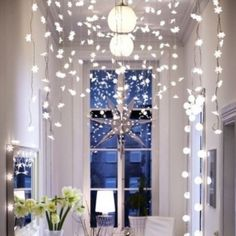 Ikea Strala Curtain of Snowflakes LED Holiday Lights, http://www.amazon.com/dp/B00FN07PQO/ref=cm_sw_r_pi_awdl_B70Ssb0R9G9HK