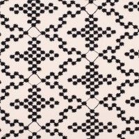 Black and white embroidered fabric