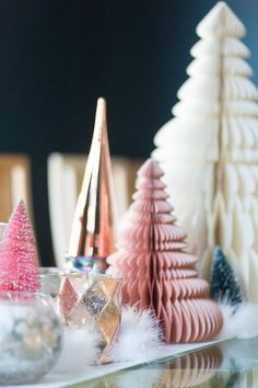 CC and Mike's Modern Eclectic Christmas Home Tour, best holiday tablescapes, gorgeus Christmas tablescape, Christmas place settings, Christmas decor ideas, copper Chistmas trees, West elm hoilday decor, Christmas decor ideas, fur Christmas decor, fur garland, beautiful Christmas dining room
