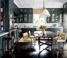lacquered teal and glass cupboards/marble backsplash