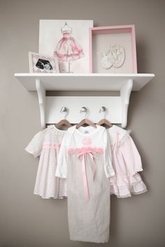 Love this baby girl shelf to display keepsakes and teeny, tiny adorable outfits