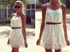 White lacy summer dress, with a brown belt and knee high brown leather boots.