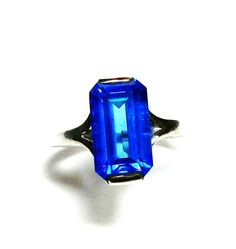 """Swiss blue topaz, birthstone ring,solitaire ring, electric blue, engagement ring, s 6 1/2    """"High Voltage"""" by Michaelangelas on Etsy"""