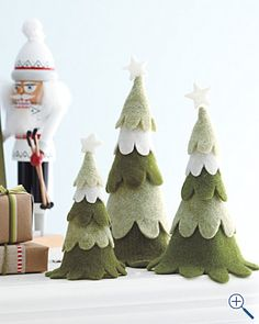 felt trees- good project to do with kids. Could maybe turn into wreaths too - link with Christmas