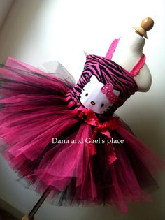 Beautiful Zebra Hello Kitty tutu and corset by DanaandGaelsplace, $43.50  My daughter is getting this to wear for her bday party!