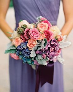 Attendants at this celebration held antique hydrangeas, Sweet Juliet roses, dusty miller, scabiosa pods, and spikes of purple veronica.