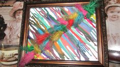 Melted crayon art. Cut them in half, and glued feathers over the shells.
