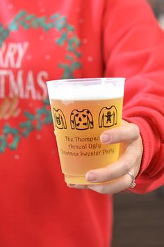 Planning an Ugly Christmas Sweater Party or annual Christmas bash? Serve holiday cocktails, beer, and punch in these reusable, 16 ounce custom printed Christmas cups to add the finishing touches to your Christmas party decorations. Belive us, your friends and family will not stop talking about your unique take home souvenirs. Personalize with a festive design like the ugly christmas sweaters shown. To view, visit http://www.tippytoad.com/16-ounce-frosted-plastic-christmas-party-cups.asp
