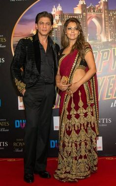 """The """"Happy New Year"""" team attended the premiere of the film in Dubai last night. The highlight of the night was Gauri Khan's presence. She accompanied Shah Rukh Khan on the red carpet looking beautiful in red and golden sari. She matched it with red nail polish and a golden clutch. Her look complemented Khan's outfit - black velvet suit with golden shoulder work - perfectly. The power couple looked amazing walking the red carpet together."""