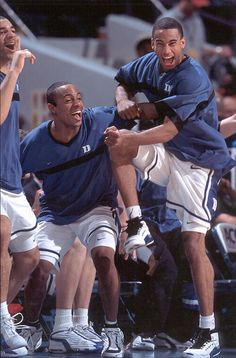 Carlos Boozer, Jason Williams and Dahntay Jones have fun on the Duke sideline during the 2001-02 season.