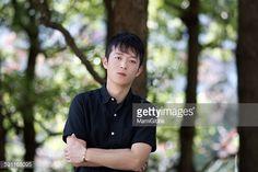 ストックフォト : Young man standing in the forest