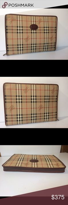 """Burberry Nova Check Document Briefcase Clutch Bag Burberry Vintage Nova Check Document Briefcase Clutch Bag ... Color: Brown ... Material: PVC / Leather ... Length: 14"""" ... Height: 10.5"""" ... Width: 1.5"""" ... Features: Zip around closure ... Zippered interior pocket ... 3 Interior slip pockets ... Condition: Normal sign of use ... Exterior leather rub ... Excellent preowned condition ... Guaranteed Authentic. Burberry Bags Laptop Bags"""