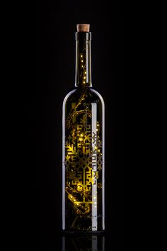 Wine bottle lamp decorated with traditional Latvian ornametn - Austras koks. https://www.facebook.com/smitalampas Photo. Matiss Markovskis
