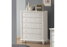 Crafted From Tropical Hardwoods And Veneers• Comes In A Lightly Distressed White Finish• Case Pieces Have Dovetail Drawers With Metal Glides• Classic Details Like Turned Posts, Simple Molding And Wood Knobsadd To The Timeless, Traditional Style• Bed Is Offered In Queen, King And Full Sizes