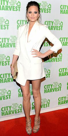 CHRISSY TEIGEN Leave it to the model to forget her skirt at home, but still look classy and absolutely flawless in a low-cut tuxedo jacket, plus metallic Jimmy Choo accessories, at the City Harvest event in N.Y.C.