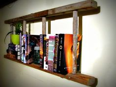 DIY bookshelf made from a wooden ladder. Rustic and clever.