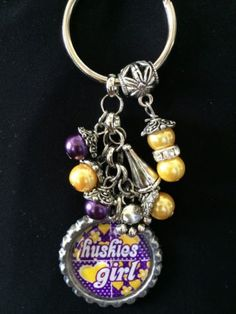 This is a handmade key chain. Made with a one inch bottle cap, epoxy seal, various beads and charm. Lightweight so it wont make your keys heavy. Looks great with that favorite jersey. Posted with eBay
