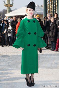 Ulyana Sergeenko wearing Pierre Cardin 1960s green coat