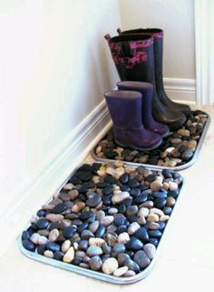 Tin tray filled with stones. Great for wet boots