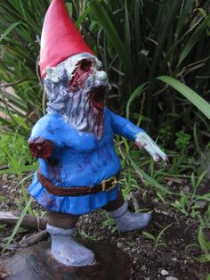 I dream about having a beautiful, peaceful garden, but... um... I don't think I'm going to be able to resist these freakin' AWESOME zombie gnomes by Chris and Jane at ChrisandJanesPlace on Etsy.  Did I mention that these are awesome?
