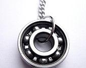 Roller Skate Bearing Necklace. $35.00, via Etsy.