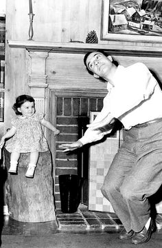 Gene Kelly with his daughter, Kerry ~ c. 1944