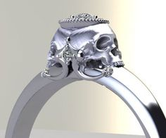 Remind your beloved that marriage is until the bitter end with this stunning diamond skull engagement ring. This elegantly morbid piece of jewelry features a double sided skull holding up a crown halo of diamonds to symbolize your eternal union.