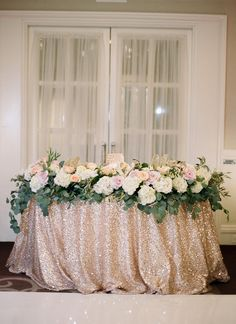 Sweetheart table with sequined linen