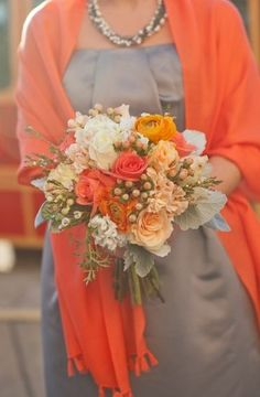 Celosia in a beautiful wrap, matched with an apricot and coral bouquet.