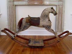 This wonderful 19th century rocking horse is still in it's original dapple gray paint.