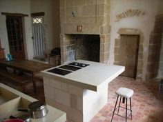 worktop concrete look rustic Mediterranean lcda kitchen island bar stools fireplace