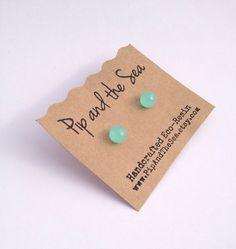 Mint green mirror-ball sphere earrings. Surgical steel studs.