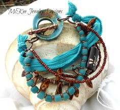 Turquoise and brown, Multi-Strand Bracelet. Ceramic, glass, copper metal, ribbon. McKee Jewelry Designs