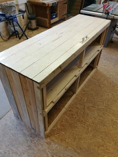 Shop counter made by us as a commission for a charity shop constructed from reclaimed pallet wood topped with a reclaimed toilet door - complete with original handle!