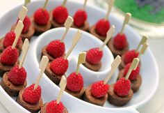 brownies in mini-cupcake pan and secure raspberry on top with toothpick. Fancy and easy! No frosting required.